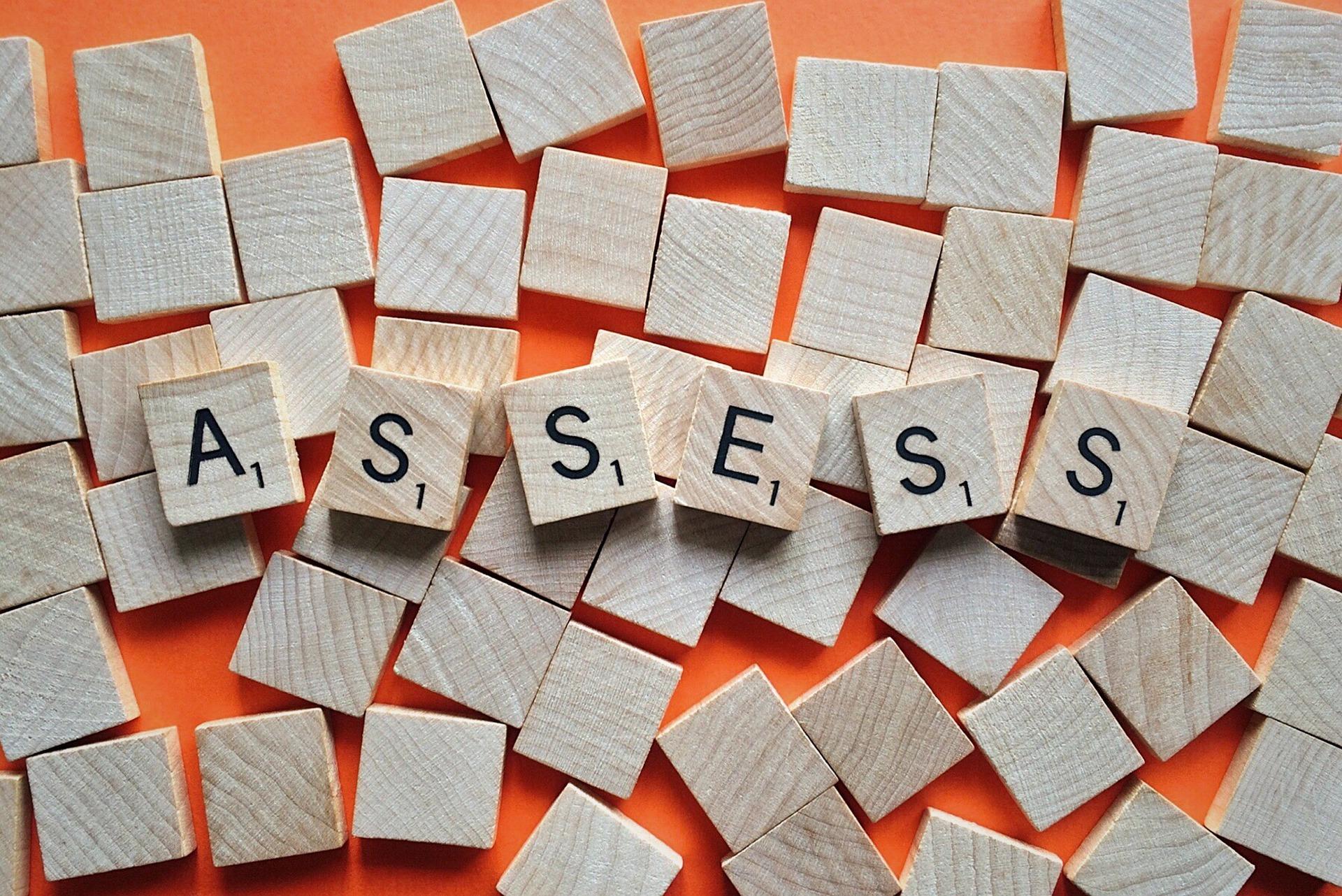 wooden scrabble blocks assess
