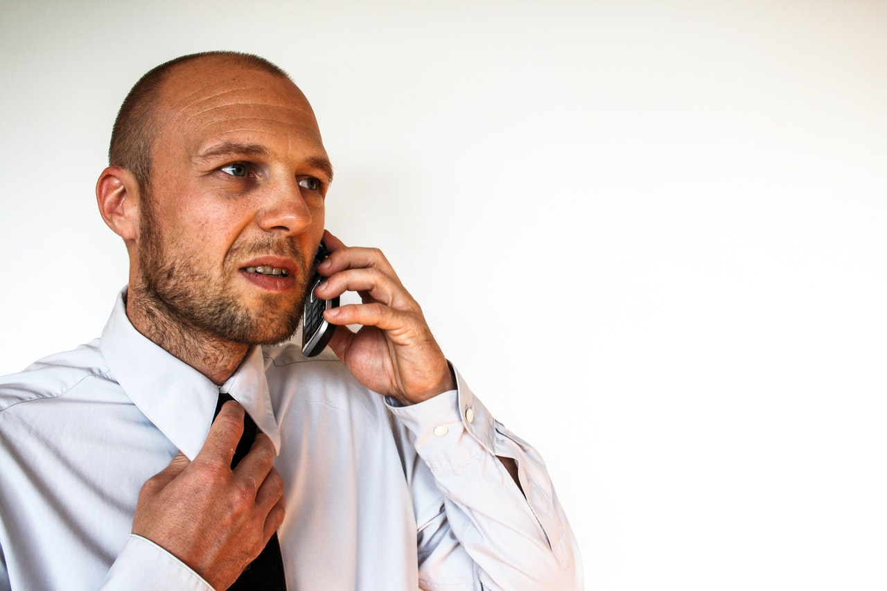 businessman worried on phone