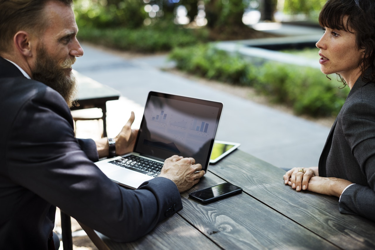 Two Business People Talking On a Bench